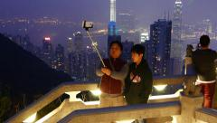 Father and son make selfie against amazing night Hong Kong cityscape Stock Footage