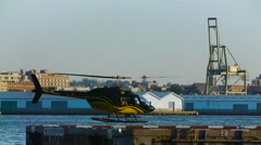 Lone Helicopter Lifts Off Toward Industrial Area- Slow Motion - stock footage