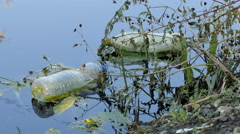 Garbage plastics bottle floating in the river Stock Footage