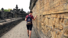 Young teenager sightseeing Borobudur temple in Indonesia Stock Footage