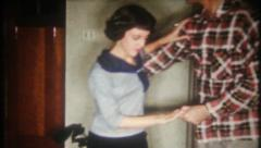 2764 - couple dance in the living room on Christmas Eve -vintage film home movie Stock Footage
