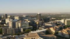 Elevated view of Sandton in Johannesburg medium pan Stock Footage