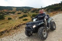Couple drive atv quad bike Stock Photos