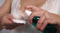 Woman cleaning neckline with cotton swab pad. 4K Stock Footage