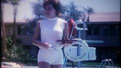 2768 - pretty cocktail waitress at Las Vegas hotel pool -vintage film home movie Stock Footage