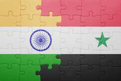puzzle with the national flag of syria and india - stock photo