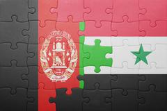 puzzle with the national flag of syria and afghanistan - stock photo