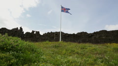 Iceland Flag Blowing In Wind In Front Of Rocky Cliff Stock Video Stock Footage