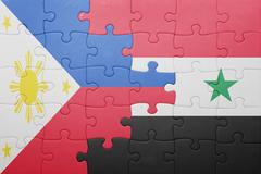 puzzle with the national flag of syria and philippines - stock illustration