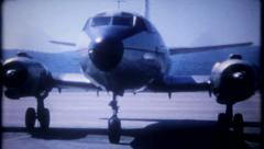 2767 - passengers wait to board propeller driven plane - vintage film home movie Stock Footage