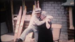 2772 - grandma & grandpa play around for the camera - vintage film home movie Stock Footage