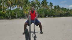 African descent male using battle ropes Stock Footage
