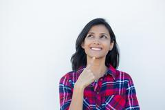 Closeup portrait, charming upbeat smiling joyful happy young woman looking up - stock photo
