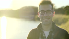 Portrait Of Happy Man Enjoy Sunset In Nature - stock footage