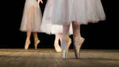 Ballerinas dancing classic ballet pas. Close up of legs of dancers of Ballet. - stock footage