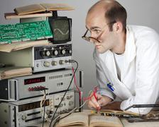 Scientist at vintage laboratory - stock photo