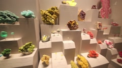 Beautiful colored gems in rocks behind glass in National Museum Stock Footage