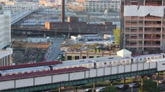 Modern moving train on overpass railroad in big city Stock Footage