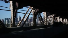 Many cars move under overpass. Focus on skyscrapers of city Stock Footage