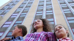 Mother with two children stand near skyscrapers. Under view Stock Footage