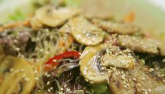 Salad with mushrooms champignon and meat Stock Footage