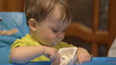 Little Boy in High Chair with Spoon Stock Footage