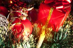 Holiday ornaments, gifts and candle Stock Photos
