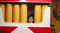 Boy in packet of cigarettes (model with release) in Giant house Stock Footage