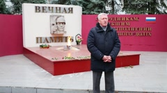 Chairman of Board of Veterans Police, A.Yarovikov speaks near memorial Stock Footage