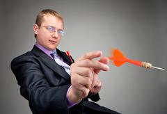 Businessman throwing red dart Stock Photos