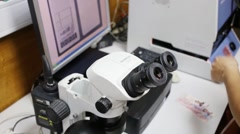 Microscope for verification of genuineness of money in police office Stock Footage