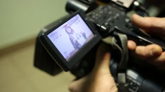 Display of camera with woman holding identikit in police Stock Footage