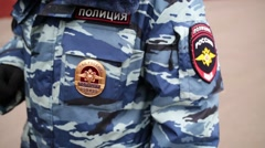 Hash marks and badge on clothes of policeman in Moscow. Stock Footage