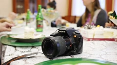 Camera Sony alfa on table during banquet in Moscow. Stock Footage