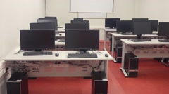 Empty classroom with computers and transparent doors Stock Footage