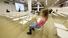 Girl sits at conference during Open Doors Day in school of design Stock Footage