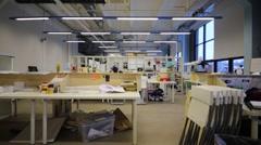 Turn on light in empty big workshop in British high school of design Stock Footage