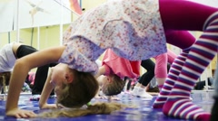 Children do exercises in gym with mirror. Two girls in focus Stock Footage