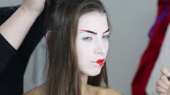 Female hands make hairdo and make up for model geisha - stock footage
