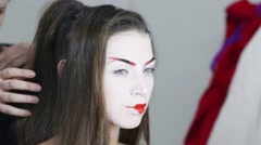 Female hands make hairdo for model geisha before shooting - stock footage