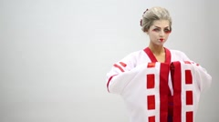 Woman in kimono with make up of Japanese geisha in studio Stock Footage