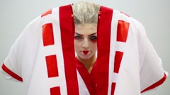Woman in kimono with make up of geisha opens and closes sleeves Stock Footage