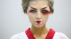 Close up of woman in kimono with make up of geisha looks Stock Footage