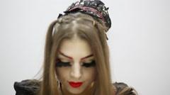 Woman with make up of geisha with false eyelashes blinks Stock Footage
