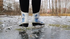 Legs of woman skating on pond on Krasnobogatyrskii creek. Stock Footage