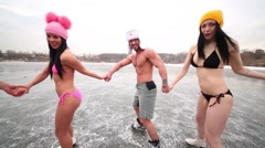 Eight people in underwear round dance on natural ice rink. Stock Footage