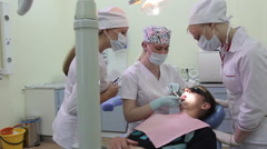 Stomatological treatment: Periodontal surgery is carried out by dentist. Stock Footage