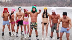 Eight young people in underwear shout on natural ice rink - stock footage