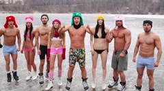 Eight people in underwear shout and gesture on natural ice rink - stock footage