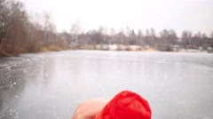 Young man in red hat hamming on ice rink at winter Stock Footage